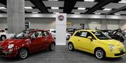 The 2012 Fiat 500C convertible, left, and the 2012 Fiat 500 are seen on display at the First Hawaiian Auto Show at the Hawaii Convention Center in Honolulu.