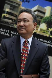 Gary Takeuchi, deputy corporation counsel for the City and County of Honolulu, speaks to the media about the rail lawsuit outside the U.S. District Court in Honolulu.