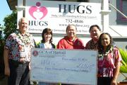 "The 2012 General Contractors Association of Hawaii's ""Give Back to the Community"" project raised more than $22,000 for the nonprofit Help, Understanding & Group Support, otherwise known as HUGS. From left, is John Romanowski, 2012 GCA president; HUGS CEO Robin Johnson; Johnny Y. Higa, GCA executive vice president; Jason Higa, HUGS board president and FCH Enterprises CEO; and Gladys Hagemann, GCA deputy director."