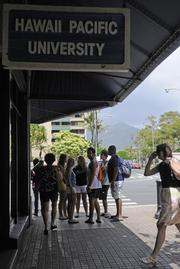 Hawaii Pacific University students outside the HPU campus on Fort Street Mall in downtown Honolulu. Maui developer Greg Hatcher plans invest $9 million to turn the vacant 12-story building into dormitories for HPU students.