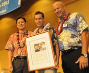 Harry Byerly, chief operating officer for Hawaii Human Resources, accepts recognition on behalf of HiHR. The company was named winner in the small-business category at Pacific Business News' 2012 Healthiest Employers awards program Thursday at the Sheraton Waikiki. Howard Lee, president and CEO of UHA, is to his left, and PBN Publisher Bob Charlet is on the right.