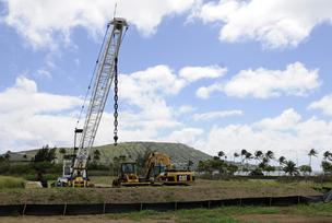 The crane parked near the intersection of Kalanianaole Highway and Keahole Street in Hawaii Kai is there for dredging Maunalua Bay. However, Kamehameha Schools and Foodland are expected to unveil a plan for the 4.5-acre parcel that would include a Foodlan