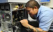 Rob Tong, field technician for Hawaii Tech Support, is trouble shooting server components for a customer.