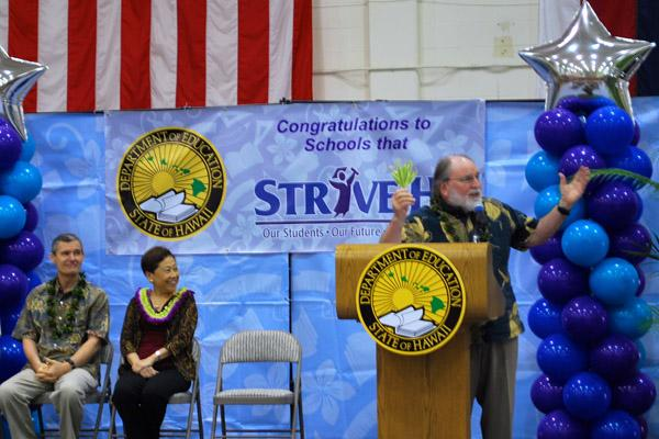 From left, Hawaii State Board of Education Chairman Donald Horner and Superintendent Kathryn Matayoshi look on as Gov. Neil Abercrombie speaks at the Strive HI awards ceremony on Friday.