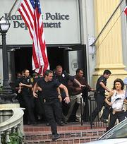 "In the ""Hawaii Five-0"" season finale, ""Ua Hala,"" Steve McGarrett, played by Alex O'Loughlin, and Kono Kalakaua, played by Grace Park, ran for cover during an explosion at Honolulu police headquarters."