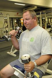 Hawaii Human Resources CEO Matt Delaney works out in the weight room at the Clark Hatch Fitness Center in downtown Honolulu. Hawaii Human Resources was named Hawaii's Healthiest Employer in the small company category.