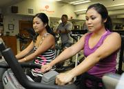 Rosalyn Bantolina, right, and Akiko Ogawa of Hawaii Human Resources exercise after hours at Clark Hatch Fitness Center in downtown Honolulu. Hawaii Human Resources was named Hawaii's Healthiest Employer in the small business category.