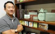 John Kim, general manager and senior vice president of the Honolulu Cookie Co., stands near some of the popular retail items on display at the company's new facility on Sand Island Access Road in Honolulu.