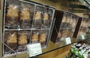 he Honolulu Cookie Co.'s signature gift box of chocolate-dipped macadamia cookies are on display at Honolulu Cookie Co.'s new facility on Sand Island Access Road in Honolulu.
