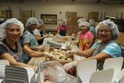 Production workers in the packing department, from left, Elena Bonilla, Nora Padilla, Josephine Gamataro and Erlinda Ramones pack cookies for amenities for an airline at the Honolulu Cookie Co.'s new facility at 255 Sand Island Access Rd.