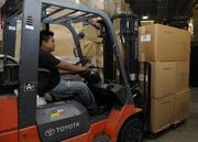 Ariel Lacara, warehouse supervisor, transports and distributes merchandise in the warehouse at Honolulu Cookie Co.'s new facility on Sand Island Access Road in Honolulu.