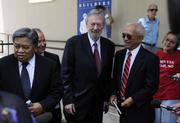 Former Hawaii Gov. Ben Cayetano speaks to the media outside the U.S. District Court in Honolulu Tuesday as fellow plaintiffs in the rail lawsuit, from left, Randy Roth, Cliff Slater and Walter Heen, look on