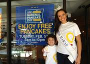Ikaika Kaahanui, a patient at Kapiolani Medical Center for Women & Children, is shown with Miss Hawaii 2012 Skyler Kamaka outside an IHOP restaurant in an effort to promote National Pancake Day. The Feb. 5 event is a fundraiser for Kapiolani, which is the only Children's Miracle Network hospital in Hawaii.