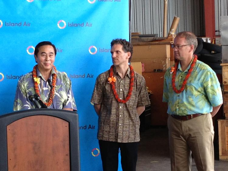 From left, Island Air President Les Murashige, Paul Marinelli of Lawrence Investments and Michael Rodyniuk of Gavarnie Holding discuss Oracle Corp. CEO and Lanai owner Larry Ellison's purchase of the airline at a news conference in Honolulu on Tuesday.