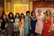 Finalist Martha Smith, chief operating officer of the Kapiolani Medical Center for Women and Children, far right, poses with her team at PBN's 2012 Women Who Mean Business event at The Royal Hawaiian in Waikiki. Event emcee Kim Gennaula, third from right, is the former director of philanthropy at the Kapiolani Health Foundation.
