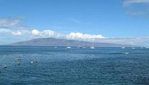 The southeastern shore of the island of Lanai as seen from Lahaina, Maui. The island's billionaire owner, Larry Ellison, plans to build a third luxury hotel on Lanai, on the site of the old Club Lanai on the shore opposite Maui.