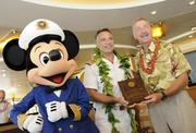 Mickey Mouse poses with Fabian Dib, captain of the Disney Wonder. and Honolulu Mayor Peter Carlisle aboard the cruise ship at Honolulu Harbor on Sunday on Disney Cruise Line's first trip to Hawaii.
