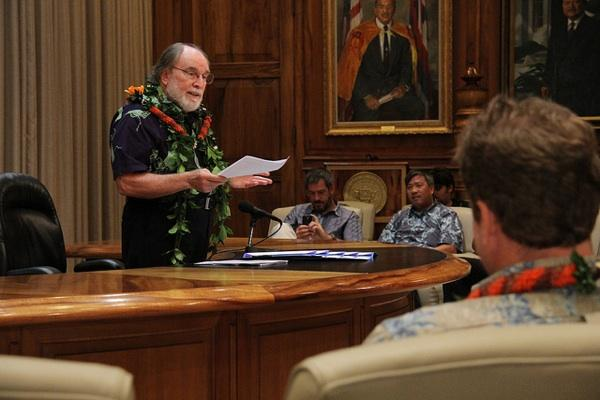 Hawaii Gov. Neil Abercrombie addresses guests at a bill-signing ceremony Wednesday in his office at the Hawaii State Capitol in Honolulu.