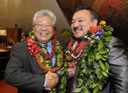 State Rep. Richard Onishi, D-Hilo-Volcano, left, shakes hands with House Vice Speaker John Mizuno, D-Kalihi Valley-Kamehameha Heights, on opening day of the Hawaii Legislature's 2013 session Wednesday.