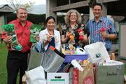 PacRim Marketing Group and its sister company, PRTech, donated wish-list items to the Hawaiian Humane Society during the holiday season. From left, is Dave Erdman, president and CEO of PacRim Marketing Group and PRTech; Alyson Winters, integrated marketing services and client services assistant for PacRim Marketing Group; Linda Ross, CFO of Hawaiian Humane Society; and Matt Malta, shelter manager for the Hawaiian Humane Society.