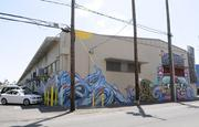 "The ""Hawaii Five-0"" scene was filmed in an alley in Kakaako near mixed martial arts fighter B.J. Penn's new UFC Gym, which opened Monday. The walls of the industrial buildings are covered with murals painted by more than 40 artists in Febuary during an event organized by Pow Wow Hawaii."
