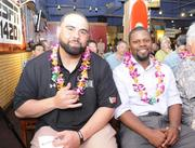 Newly appointed University of Hawaii football defensive assistant coaches Lewis Powell, left, and  Daronte' Jones.