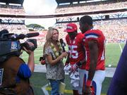 NBC's Alex Flanagan interviewed San Diego Chargers tight end Antonio Gates, left, and Cincinnati Bengals wide receiver AJ Green, right, on the sidelines at the NFL Pro Bowl at Aloha Stadium. NBC broadcast the game to a national audience.