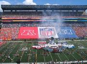 Pre-game festivities on the field for the NFL Pro Bowl included pyrotechnics, cheerleaders, music, dancers and other entertainment to get the crowd pumped up before kick off.