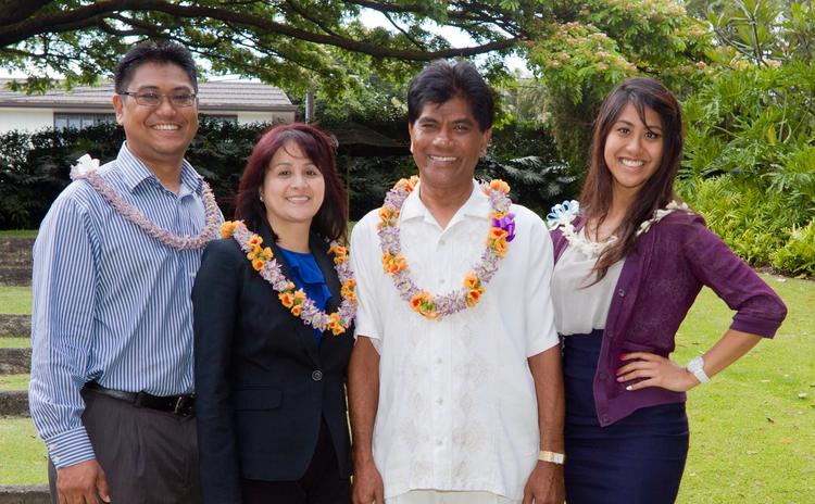 House of Finance CEO Roland Casimina and his wife, Evelyn, center, are seen with their son, Matthew, and daughter, Celine, in this photo provided by the University of Hawaii Shidler College of Business.