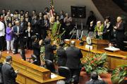 Hawaii Gov. Neil Abercrombie gives the audience a thumbs up following his state-of-the-state address.