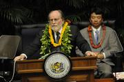 Hawaii Lt. Gov. Shan Tsutsui is seen seated behind Gov. Neil Abercrombie during his state-of-the-state address on Tuesday.