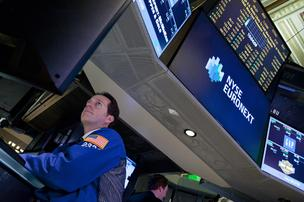 A trader works on the floor of the New York Stock Exchange in this March 5 photo by Bloomberg.