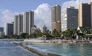 Waikiki's hotels form the backdrop behind a project to replenish the sand of Hawaii's most famous beach. The project involves pumping some 24,000 cubic yards of sand from deep-water areas 1,500 to 3,000 feet offshore and trucking it to the area between the Duke Kahanamoku statue and the Royal Hawaiian Hotel.