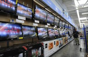 The new Walmart store in Kapolei, Hawaii, features an expanded electronics section with flat-screen televisions, seen here, and other home entertainment items.