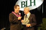 John Henry Felix, chairman, president and CEO of the Hawaii Medical Assurance Association, is presented with this year's American Savings Bank Business Leader of the Year award by the bank's president and CEO, Richard Wacker.