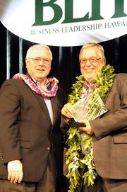Larry Rodriguez of Central Pacific Financial Corp., presents attorney Jeffrey S. Portnoy of Cades Schutte with the 2011 Business Leadership Hawaii Sponsor's Legacy award for his years of support and dedication to the BLH program. Cades Schutte has been a sponsor of the BLH program since 2003. Rodriguez received the BLH Lifetime Achievement award in 2009.