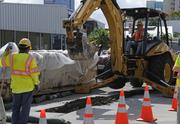 Workers perform an archaeological survey for  Honolulu's proposed rail route near the intersection of Cooke and  Halekauwila streets on Wednesday, Sept. 12. The first human remains were  reportedly discovered near the site.
