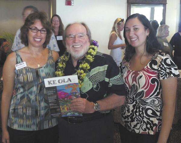 Ke Ola Magazine Publisher Barbara Garcia, left, and her daughter, Mariana, pose with Gov. Neil Abercrombie at a Kona-Kohala Chamber of Commerce Business Expo in March.