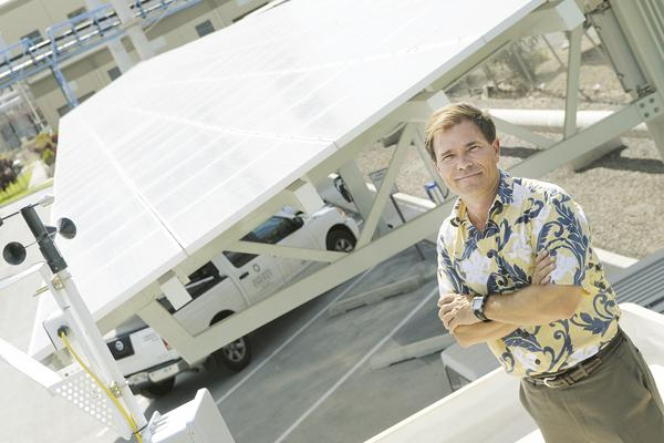 Island Pacific Energy President Joe Saturnia shows off a 450-panel, 128-kilowatt installation atop Hawaiian Electric Co.'s Campbell Industrial Park parking structure.