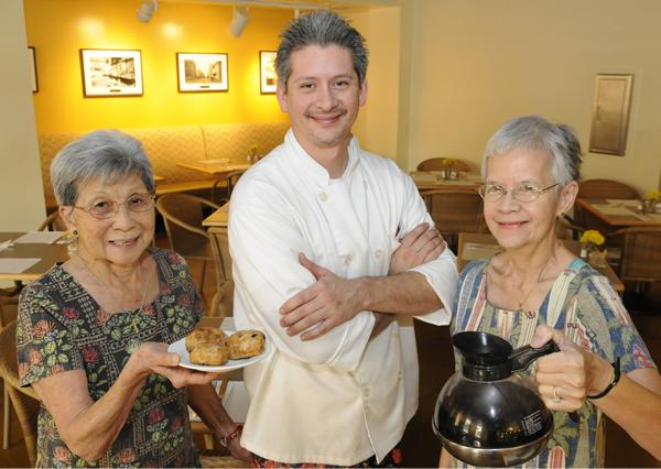 Grand Cafe & Bakery owners Patsy Izumo,  left, Anthony Vierra and Mona Chang Vierra are finally open for business after negotiating a lease with the state.