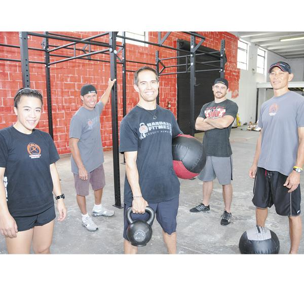 Hardass Fitness coaches, from left, are Sabrina Nguyen, Pat Von, Kimo Kockelman, Joe Szymanek and Todd Tamanaha. They are shown in their new facility at 768 South St., which will open July 4.