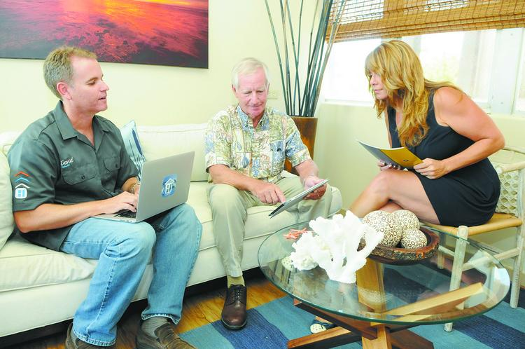 Discussing a client are members of the Hawaii Life Real Estate Brokers Kahala team, from left, David Buck, broker in charge; Mark Buck, Realtor; and Jayney Sharpe, Realtor-associate.