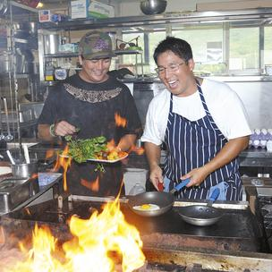 Business partners Russ Inouye, left, and Mark Noguchi cook up customer orders in the kitchen of their new eatery, Heeia Pier General Store & Deli. They have a new 35-year lease on the Kaneohe landmark.