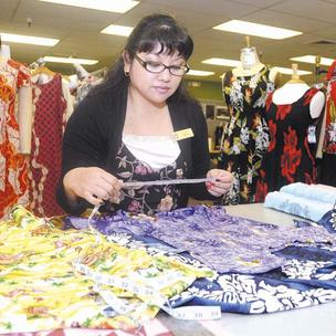 Local cruise ship vendors seeing signs of hope  Rosalie Paradeza, product development technician for Hilo Hattie, reviews the merchandise and checks on the quality of sewing and measurements of all garments prior to being ready for Norwegian Cruise Line.
