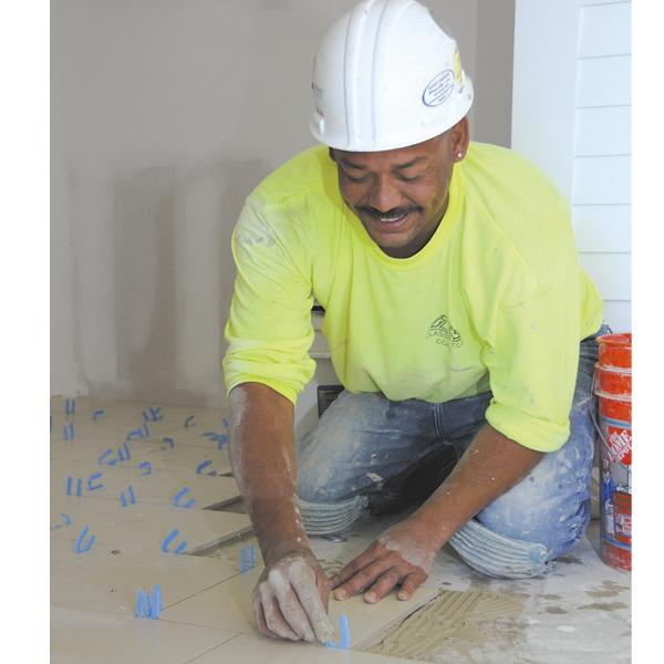 Joshua Santiago, a tile setter with Classic Tile, works in the Hilton Hawaiian Village Beach Resort & Spa's Rainbow Tower, which is renovating floors 3 through 31.