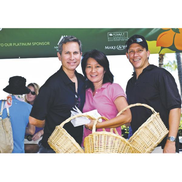 Hyatt employees volunteering for Swing for Wishes 2010 are, from left, Terry Hubbard, director of art; Sheryl Siu, director of retail operations; and Branden Baker, regional director of information technology.