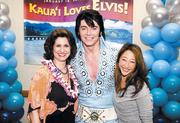 "Sue Kanoho, left, executive director of the Kauai Visitors Bureau, and Mollie Horner, right, director of marketing for the Kauai Visitors Bureau, pose with Elvis Presley tribute artist Tim Welch at the ""Kauai Loves Elvis!"" fundraising event on Jan. 18 at the Kauai Marriott Resort on Kalapaki Beach. The event raised money for the Kauai United Way."