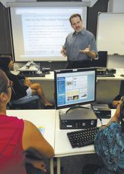 Kenneth Newman, senior vice president of information security for Central Pacific Bank, leads an employee training session on data security.