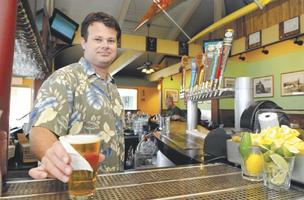 Jetsun Dutcher, general manager of Kona Brewing Co. in Hawaii Kai, prepares a glass of Duke's Blonde Ale for a customer.