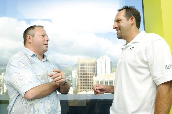 Matthew Delaney, left, president and CEO of Hawaii Human Resources, talks with co-owner and Executive Vice President Scott Meichtry in the penthouse of the Topa Financial Center's Fort Street Tower. HiHR is moving there this year.